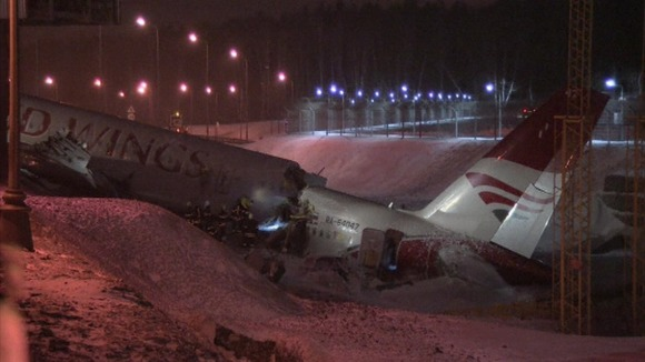 The back end of the plane remains in a ditch at the end of the runway