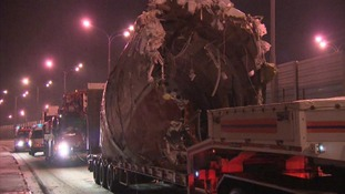 The remains of the plane have been put on to flat bed trucks and removed from the airport
