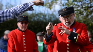 Chelsea pensioner John Denton, 81, (right) takes part in the annual World Conker Championships.