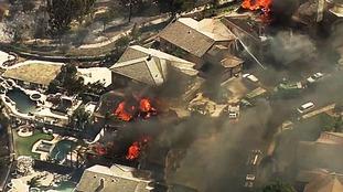 A fire burns in the Anaheim Hills.