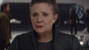 The late Carrie Fisher appears in the new trailer.