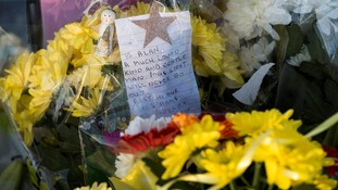 Flowers and tributes were left at the spot where Alan Greaves was attacked