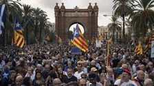 Independence supporters in Barcelona await the outcome of the speech.
