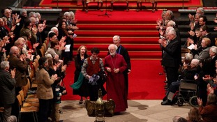 The Archbishop of Canterbury Dr. Rowan Williams accompanied by family members, leaves Canterbury Cathedral in Kent.