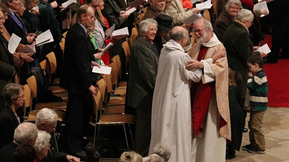 The Archbishop of Canterbury Dr. Rowan Williams 62, greets members of the congregation.
