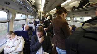 File photo of commuters on a train as rail fares get set for another above inflation rise