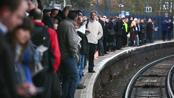 File photo of commuters on a platform as rail fares get set for another above inflation rise