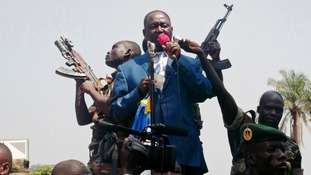 Central African Republic President Francois Bozize speaks to anti-rebel protesters in Bangui during an appeal to US and France for help.