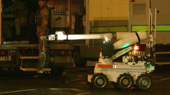 An army bomb disposal expert prepares to move in to examine the device