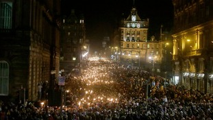People take part in the torchlight procession through Edinburgh which starts the city's Hogmanay celebrations.
