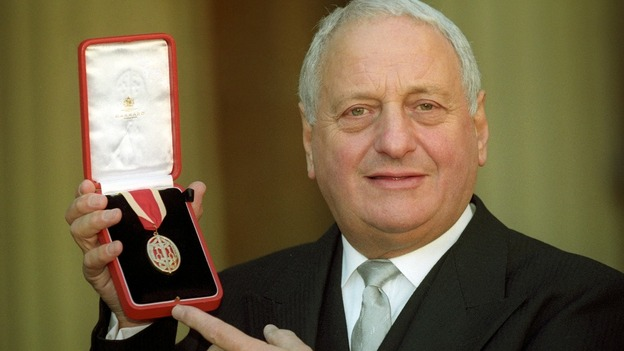 Sir Irvine Patnick pictured receiving his knighthood at Buckingham Palace in 1994