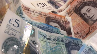 The couple were conned out of more than £21,000 by a man posing as a police officer.