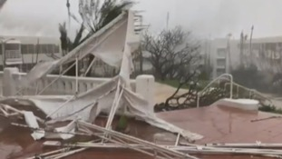 An estimated 95% of the roofs were blown off in some towns