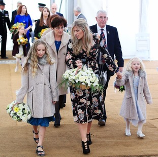 Jen Phillips, the widow of Pc Dave Phillips and their daughters Abigail and Sophie at the unveiling of a memorial for the PC.
