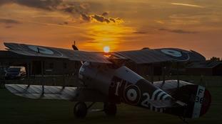 A light aircraft parked at sunset