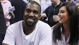 Rap musician West and Kardashian watch basketball in Miami on December 6