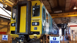 A train undergoing wheel repairs at the Canton depot