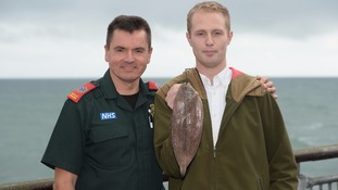 Sam Quilliam holds a Dover sole.