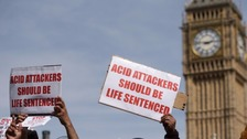 People protest against acid attacks.