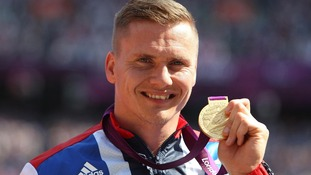 David Weir with his gold medal after winning the Men's 5000m - T54 at the Olympic Stadium.
