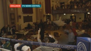 Exclusive footage shows chairs being thrown by crowds at boxing match