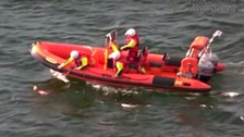 A video still issued by the Maritime and Coastguard Agency of the dog being swept out to sea.