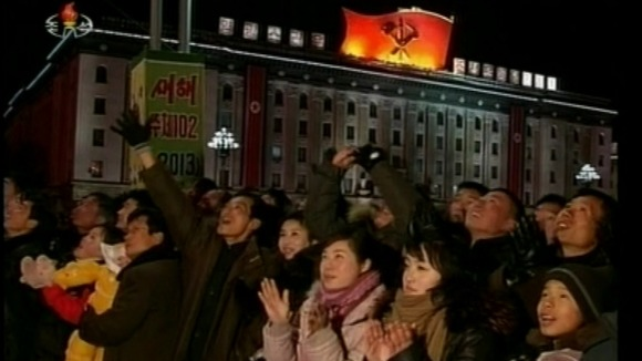 People on the streets of Pyongyang enjoy the fireworks as North Korea celebrates the New Year