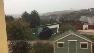 A trampoline was filmed being hurled through a garden as Storm Ophelia blasted through Ireland.