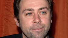 Tributes paid to comedian Sean Hughes