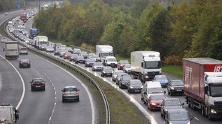 Tailbacks developed on the M77 heading into Glasgow after a lorry overturned in high winds.