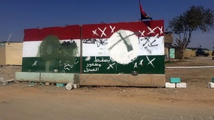 Barriers with defaced Kurdish flags are seen outside of an evacuated checkpoint south of Kirkuk.