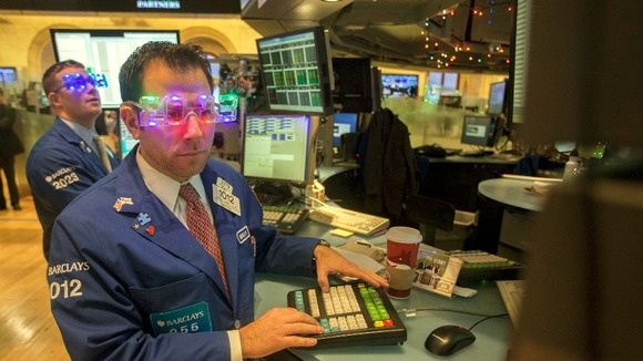 Trader Michael Pistillo wears &quot;2013&quot; glasses celebrating New Year&#x27;s Eve as he works on the floor of the New York Stock Exchange