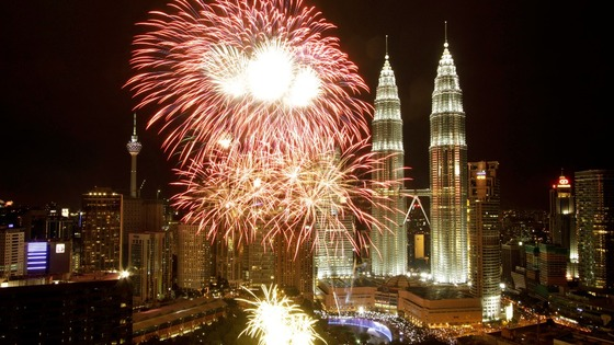 Malaysia&#x27;s landmark Petronas Twin Towers are lit by fireworks as part of New Year celebrations in Kuala Lumpur