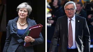 Theresa May receives a warm embrace from Jean-Claude Juncker.