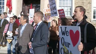Protesters outside the meeting at Shire Hall