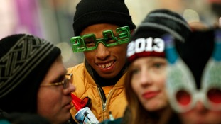 Revellers gather in Time Square before celebrating the New Year in New York