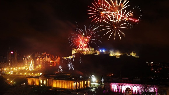 Fireworks go off over Edinburgh Castle as part of the new year 2013 Hogmanay celebrations