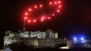 Edinburgh Castle is topped with a ring of fireworks as part of Hogmanay festivities