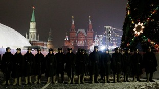 Russian interior ministry soldiers stand in line ahead of New Year's Day in Red Square in Moscow