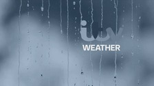 Cloudy with occasional rain or drizzle