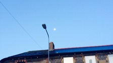 Street light and moon