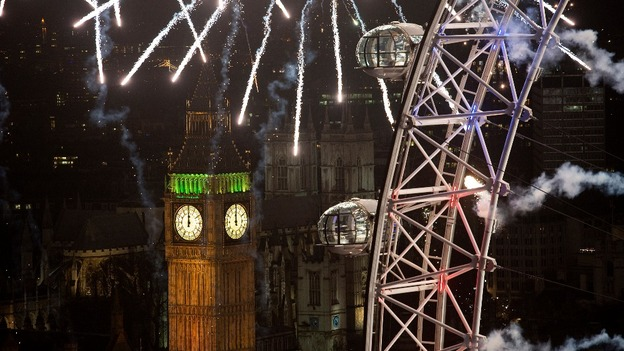 Big Ben is seen with the London Eye covered in fireworks.
