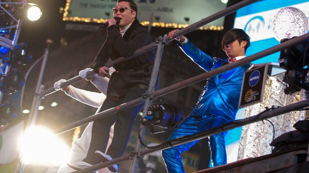 Psy sings Gangnam Style during a sound check for a New Year celebration concert in New York