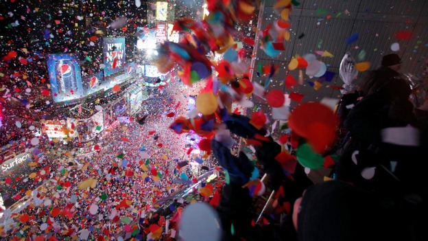 Revellers are sprayed with confetti in Times Square, New York.