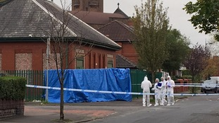 Forensic team at scene of stabbing on Worsley Avenue in Moston