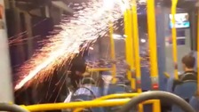 Firework thrown inside bus as doors open