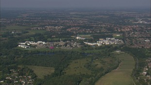 Police appeal to identify a woman rescued from a lake at the UEA in Norwich.