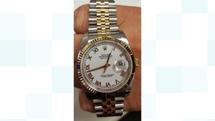 A Rolex watch, like this one, was stolen.