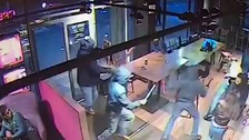 Masked robbers raid coffee shop with bats and hammers