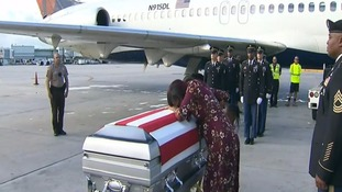 Myeshia Johnson with husband's coffin